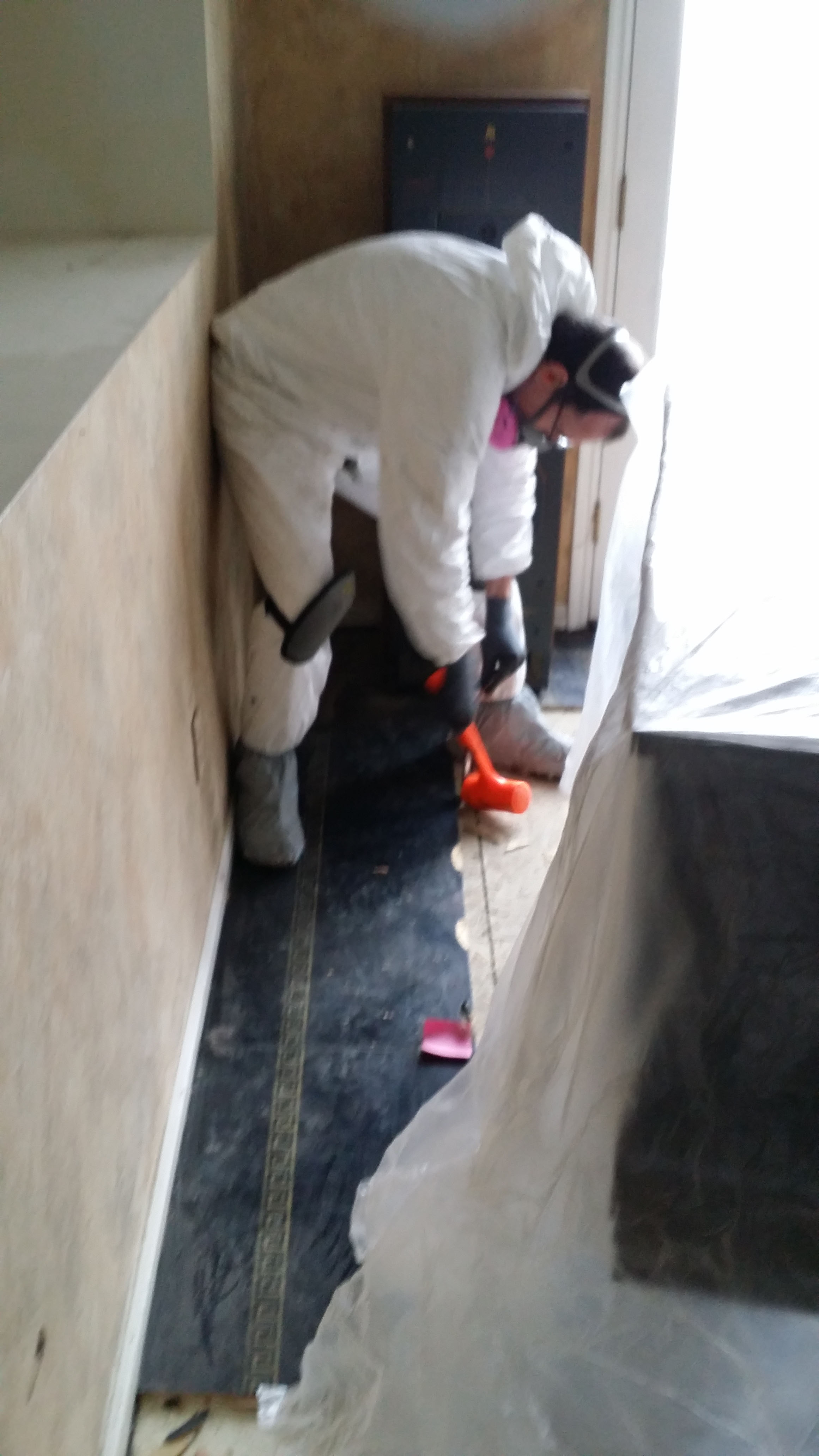gav prying up floor key stone - BLOG