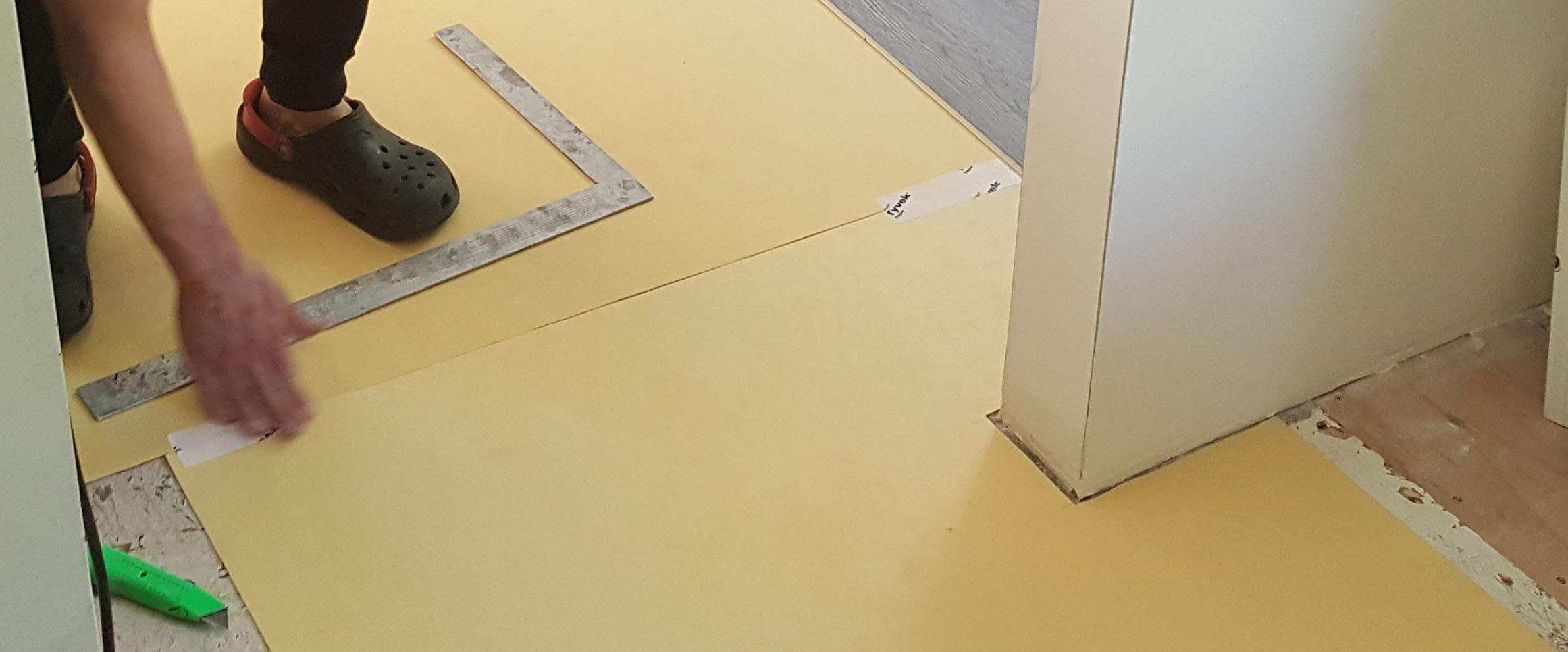 Underlayment around kit door